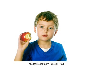 Close-up portrait of a little boy eating red apple isolated on white background