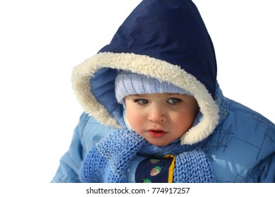 close-up portrait of a little boy in winter clothes on white isolated background