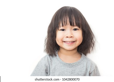 Closeup portrait of little cute asian girl, lovely small asian girl  happy and fun expression isolated on white background. Education concept