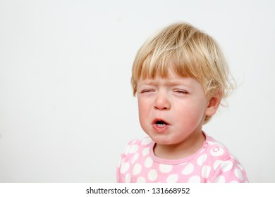 closeup portrait of little girl crying w/ closed eyes