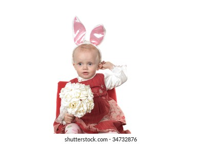 Closeup portrait of little girl with hare ears sitting on the chair