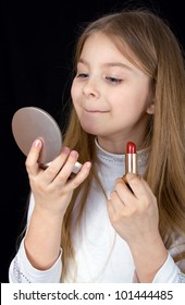 closeup portrait of the little girl with lipstick