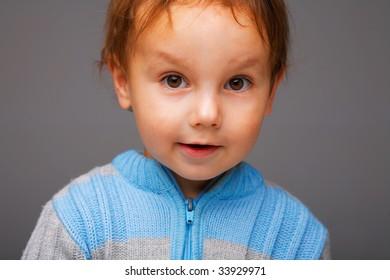 Closeup portrait of a little smiling boy