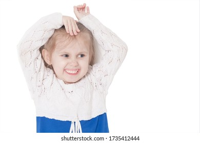 closeup portrait of a little smiling three year old girl on a white background, isolate