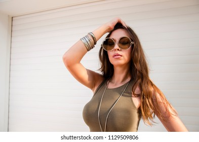 Closeup portrait of long hair brunette with stylish sunglasses ; summer fashion