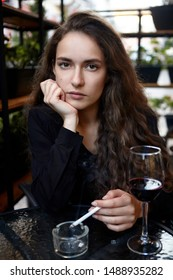 Closeup portrait of long haired curly beautiful girl. With cigarete .Smoking