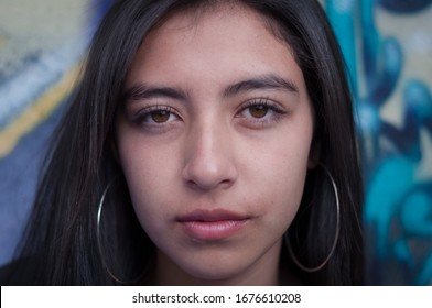 close-up portrait of long-haired latin girl face looking frontally