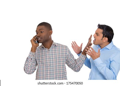 Closeup portrait of loud obnoxious rude guy talking loudly on cell phone, another man complains and gets face palm. Isolated on white background. Negative emotion facial expression feelings