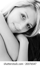 Closeup portrait of lovely blond. Black-and-white photo