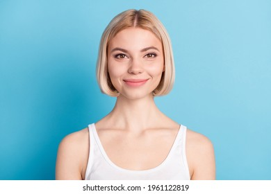 Close-up portrait of lovely cheerful blond girl wearing tanktop isolated over vivid blue color background