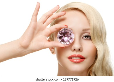 closeup portrait of lovely girl covering her eye by fake diamond isolated over white background