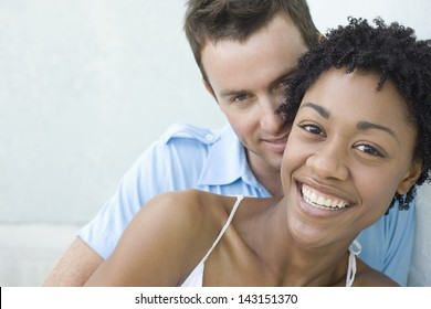 Closeup portrait of loving young couple smiling