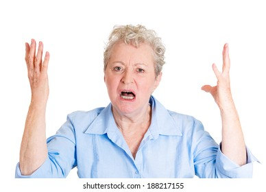 Closeup portrait, mad, angry, upset, hostile, senior mature woman, worker, furious employee, yelling, screaming, hands in air, isolated white background. Negative emotions, facial expression reaction