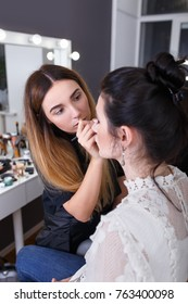 closeup portrait of makeup artist at work in her studio