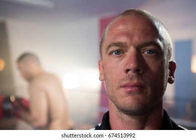 Close-up portrait of male athlete at fitness studio
