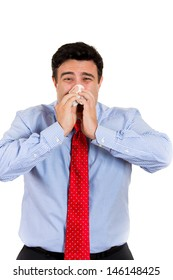 Closeup portrait of male with cold and blowing nose in kleenex, isolated on white background