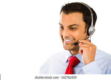 A close-up portrait of a male customer service operator wearing a headset with copy space to left, isolated on white background