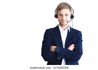 A close-up portrait of a male smiling handsome customer service center operator wearing a headset with copy space to left, isolated on white background.