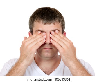 Close-up portrait of a man closing his eyes with his hands on a white background studio