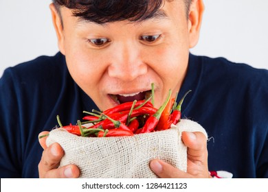 Close-up Portrait of a man eating chili,Asian men and chili,man with chili in his hand