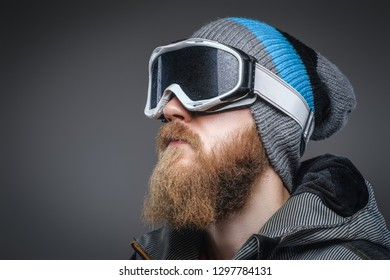 5b612d17504 Close-up portrait of a man with a red beard wearing a winter hat