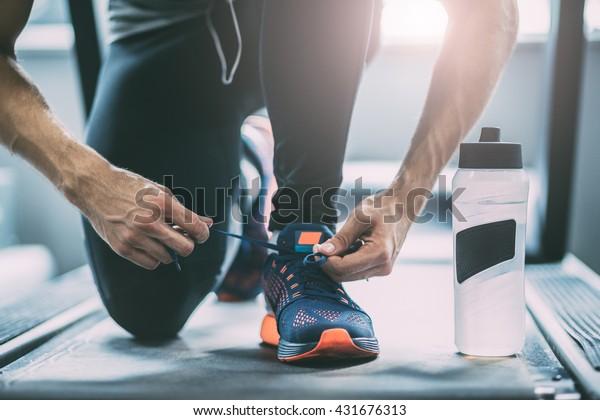 Closeup portrait of a man tying shoelaces
