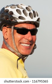 Closeup portrait of man wearing a helmet and shades