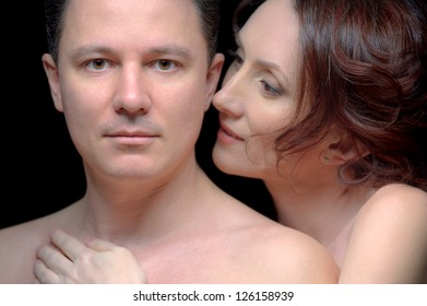 Closeup portrait of man and woman over black