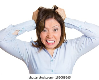 Closeup portrait, mature stressed woman pulling her hair out about to have nervous breakdown, isolated white background. Negative human emotions, facial expressions, reactions, attitude, feeling