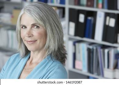Closeup portrait of a middle aged businesswoman smiling