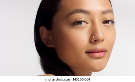 closeup portrait of mixed race model with ideal skin no makeup natural makeup. Korean mixed race model
