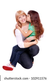 Closeup portrait of mother and daughter kissing mom a in white studio