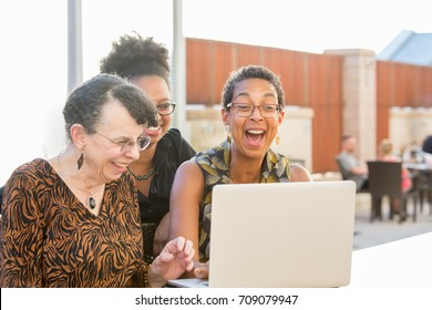 Closeup portrait, multigenerational family looking at something exciting on laptop, isolated outdoors background