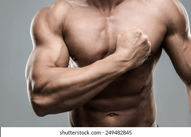 Closeup portrait of a muscular man beating his chest