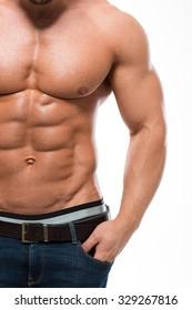 Closeup portrait of a muscular man with nude torso