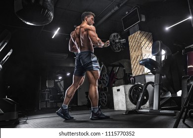 Closeup portrait of a muscular man workout with barbell at gym. Brutal bodybuilder athletic man with six pack, perfect abs, shoulders, biceps, triceps and chest. Deadlift barbells workout.