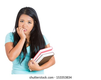 Closeup portrait of nervous student carrying books in one arm and biting fingernails in other, isolated on white background with copy space