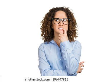 Closeup portrait nervous woman with glasses biting her fingernails craving for something, anxious, isolated white background with copy space. Negative human emotions, facial expressions, body language