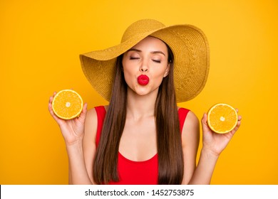 Close-up portrait of nice attractive glamorous lovely charming posh dreamy straight-haired lady holding in hands pieces of fresh orange kissing you isolated on bright vivid shine yellow background