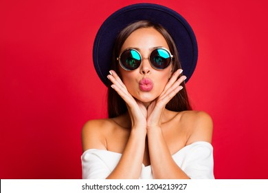 Close-up portrait of nice cool bright vivid attractive sweet lovely positive lady wearing white off-the-shoulders ruffles top blouse sending kiss holding cheeks in palms isolated over red background