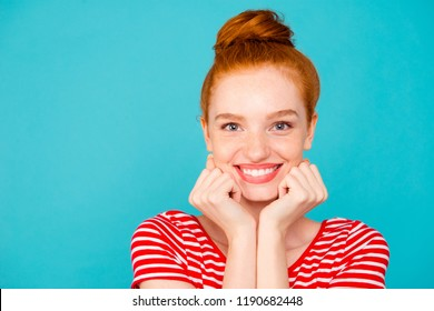 Close-up portrait of nice cute attractive adorable magnificent lovely cheerful optimistic red-haired girl with bun, beaming smile, isolated on bright vivid blue background