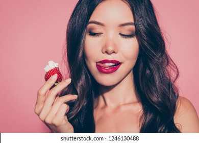 Close-up portrait of nice cute luxury lovely sweet attractive adorable wavy-haired lady licking red lips want wish looking at whipped cream dessert isolated over pink pastel background