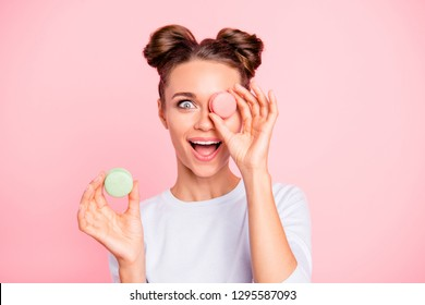 Close-up portrait of nice cute winsome attractive cool funny girlish girl closing covering one eye with sugary colorful pie opened mouth isolated over pink pastel background