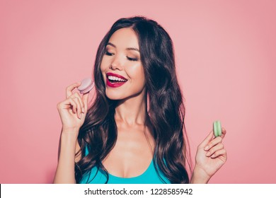 Close-up portrait of nice dreamy cheerful foxy curious lovely sweet delicate winsome adorable glamorous charming attractive wavy-haired lady eating dessert bakery red lips isolated on pink background