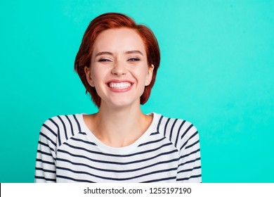 Close-up portrait of nice lovely charming attractive cheerful optimistic positive red lady wearing striped pullover isolated over bright vivid shine green turquoise background