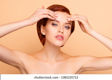 Close-up portrait of nice lovely sweet attractive charming winsome girl touching forehead healthy clean clear smooth perfect flawless shine skin wellness isolated on beige background