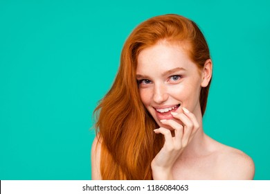 Close-up portrait of nice nude cunning sweet tender adorable cheerful red-haired girl with shiny pure clean fresh smooth flawless skin, touching chin, isolated over green turquoise background