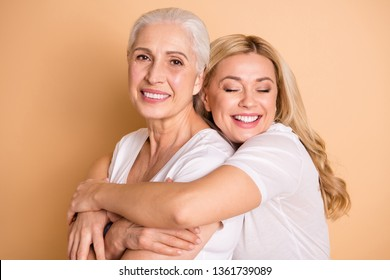 Close-up portrait of nice-looking attractive cute charming sweet tender gentle lovely cheerful ladies supporting granny mom mommy mum isolated over beige pastel background