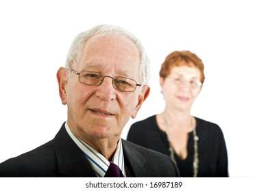 closeup  portrait off a senior businessman with colleague in the background isolated on white