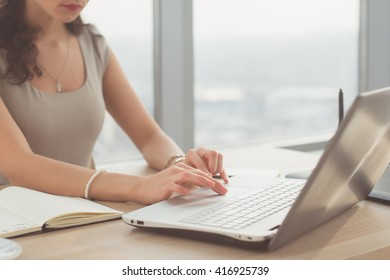 Close-up portrait of an office worker browsing, searching and analyzing new business ideas, surfing the internet at her workplace.